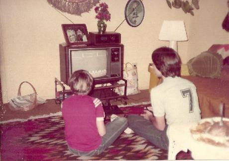 1980s living room playing atari 2600