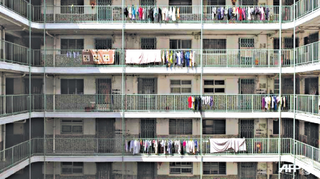 laundry drying Kowloon government tenement in Hong Kong Photo AFP